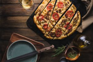 Focaccia Recipe With Caramelized Onions, Tomatoes, And Fresh Rosemary
