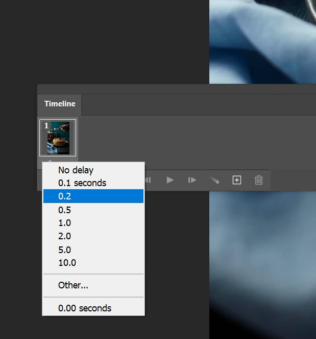Photoshop requires you to select a delay between each frame for your gif